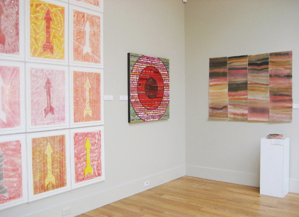 Immediately identifiable: Installation from the 2013 exhibition, Swept Away: Translucence, Transparence,Transcendence at the Cape Cod Museum of Art with, from left: David A. Clark arrow prints, Nancy Natale bricolage with tacked elements, Laura Moriarty geologic sculpture and prints. Photo by the author