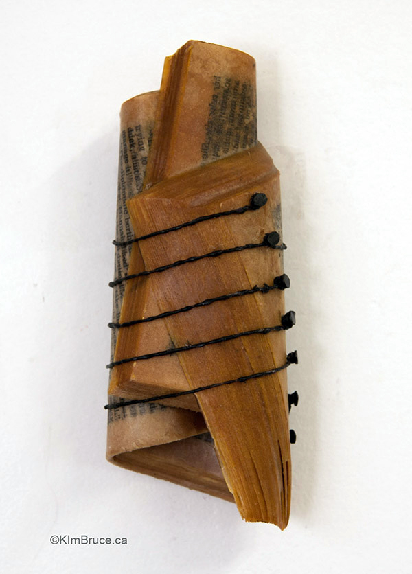 , Kim Bruce, 6th String Missing, 2016, encaustic medium, string, furniture tacks on a book, 5.5 x 2.5 x 1.25 inches
