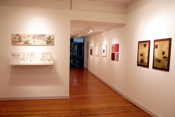 The original R&F gallery was in an entry and hallway leading to the factory at the shop's location on Broadway in Kingston, New York. On left wall: Cynthia Winika; in hallway: Rachel Friedberg (in distance), Nancy Azara, Timothy McDowell